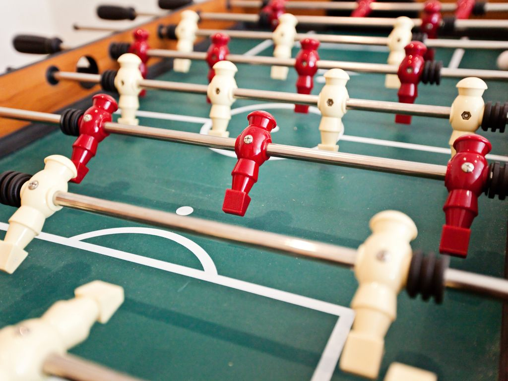 Play a game of foose ball to the delight of the kiddos