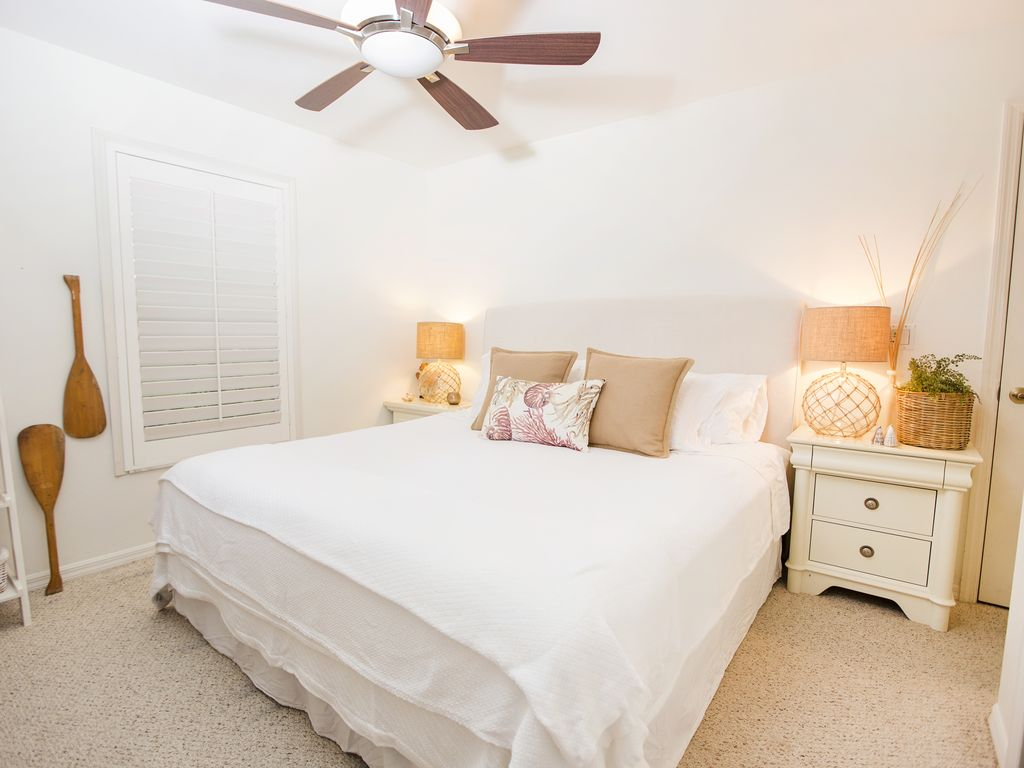 Lots of light is floating into the spacious guest bedroom with a king bed
