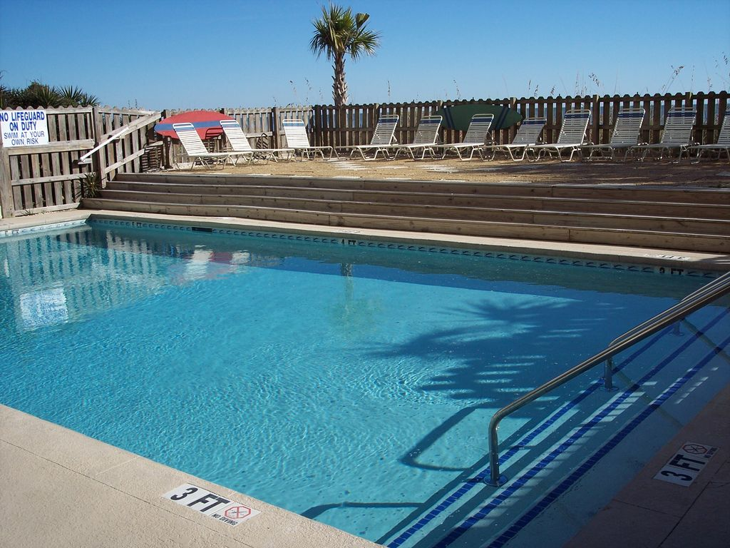 - Outdoor pool with sundeck overlooking the dunes