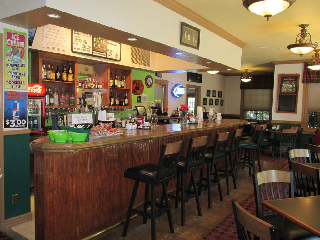 The bar and grill is open during the golf season. Only 1 block from your condo.