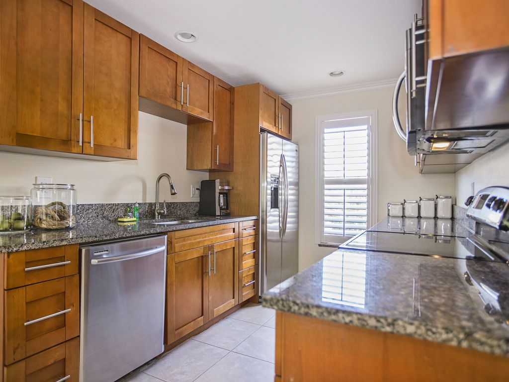 Rural kitchen with high-end stainless steel appliances and granite countertops.