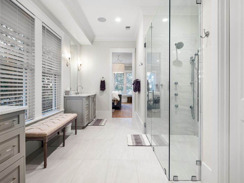 Master bathroom with double vanity and spacious closet