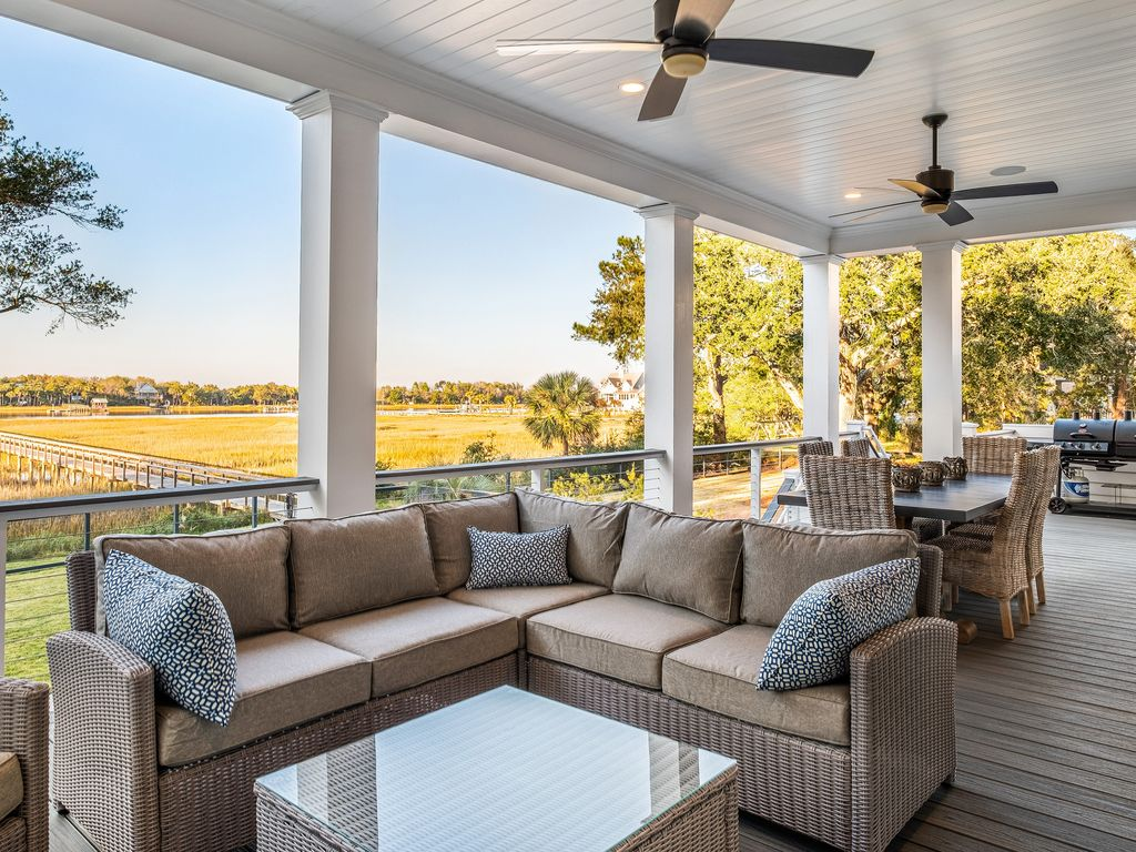Deck off living room and kitchen with outdoor TV