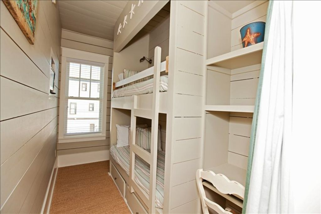 Bunk room on the second floor, has a built in TV and a full bath.
