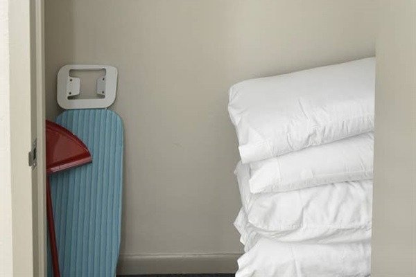 Complete with an iron and ironing board, extra comfy pillows, and linens for your stay!