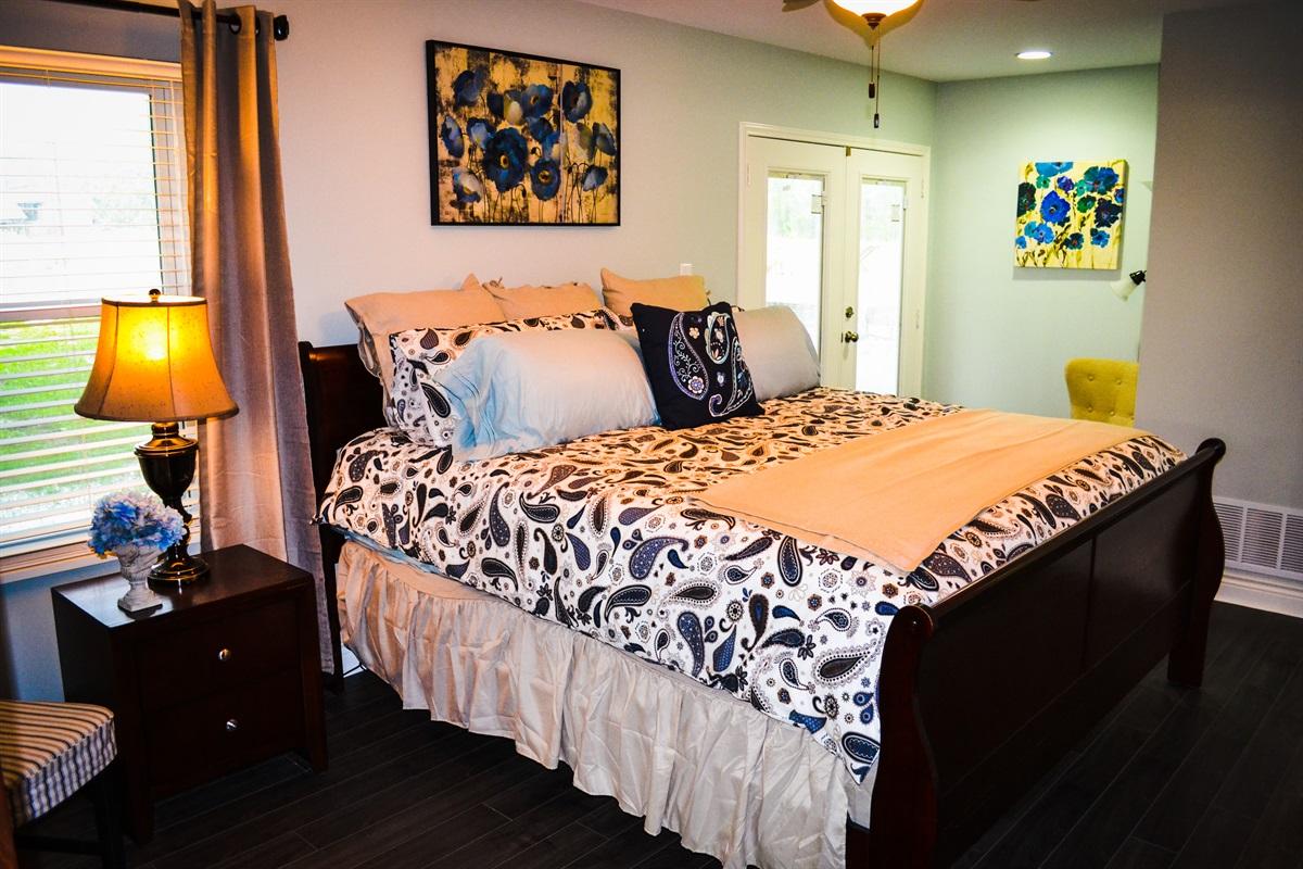 Master bedroom w/ king bed.