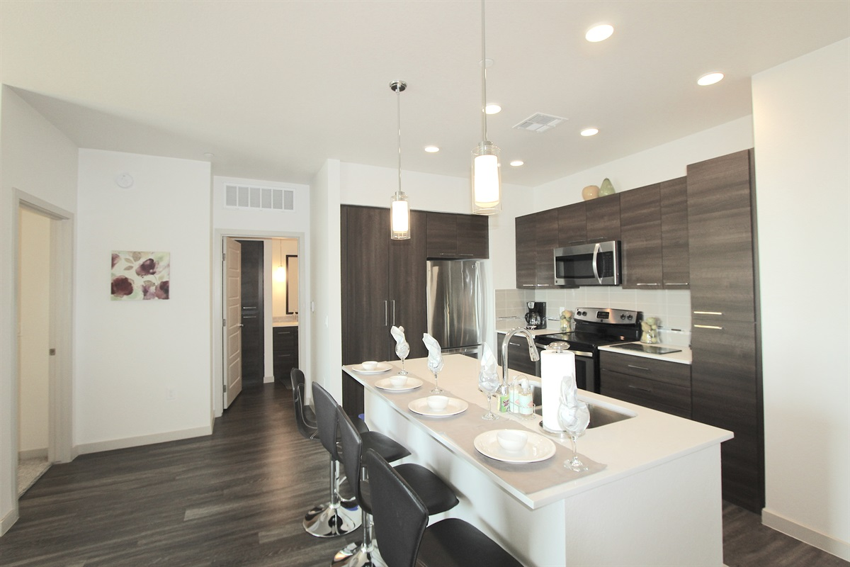 Kitchen has Quartz counters, seating for four.