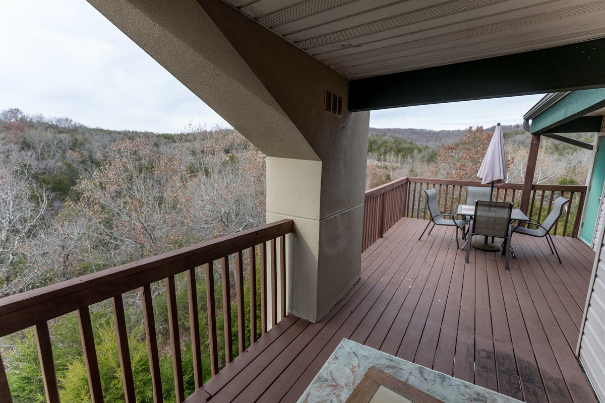Covered deck with Ozark mountain views