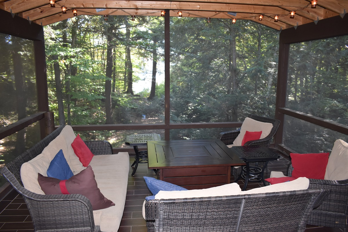Enclosed Porch with a Fire Pit Table.