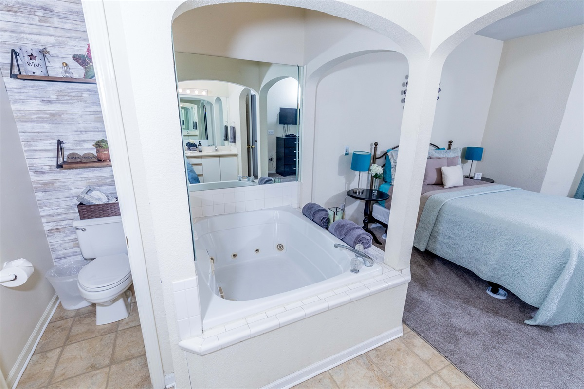 The master bathroom has a wonderful large Jacuzzi for two!