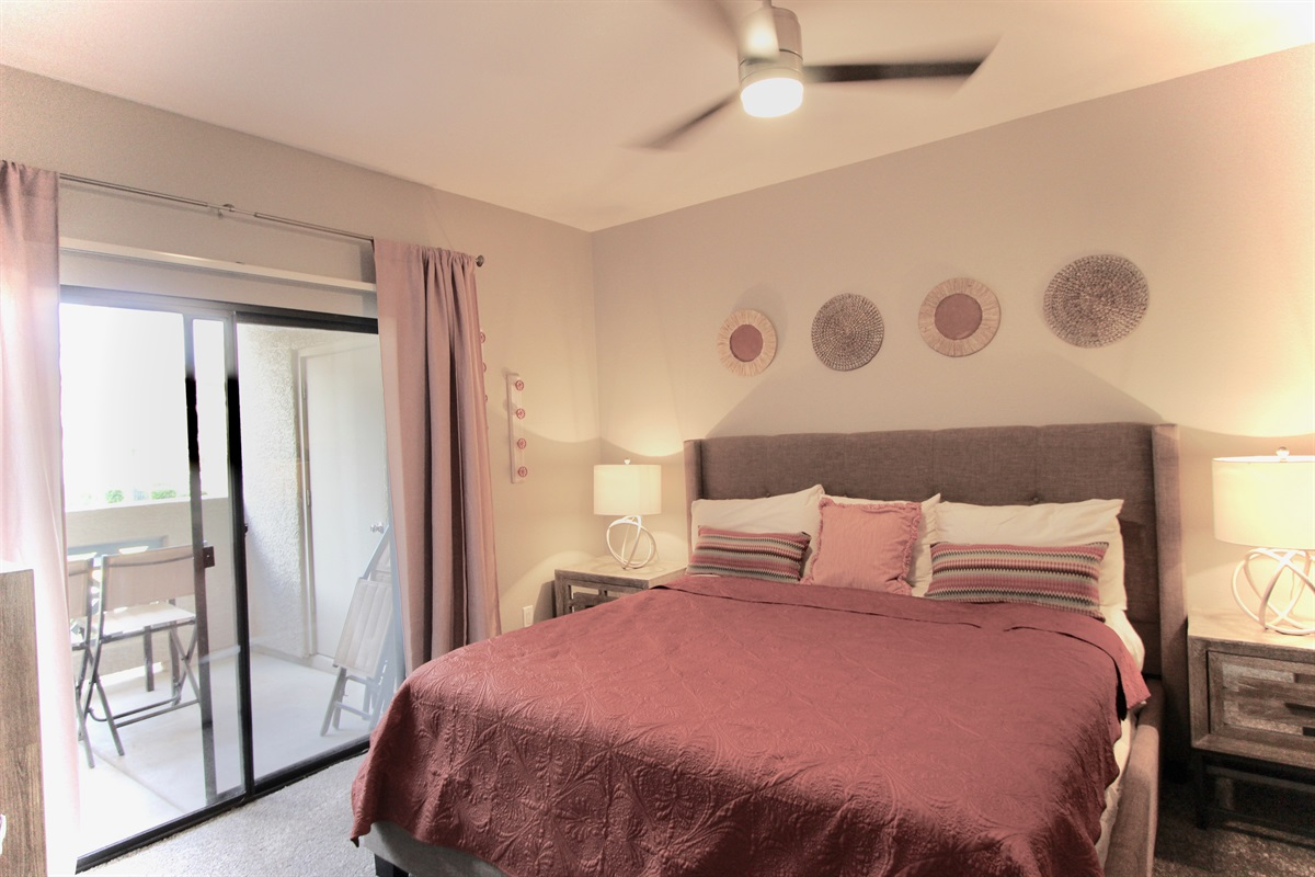 Master bedroom with king bed, walk in closet, walk out to patio.