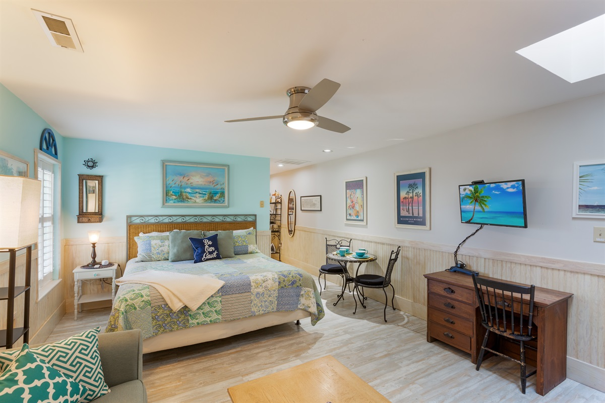 "Welcome to this ""Key West"" themed condo, with large living space - kitchenette is to the right.  TV with Comcast Cable"