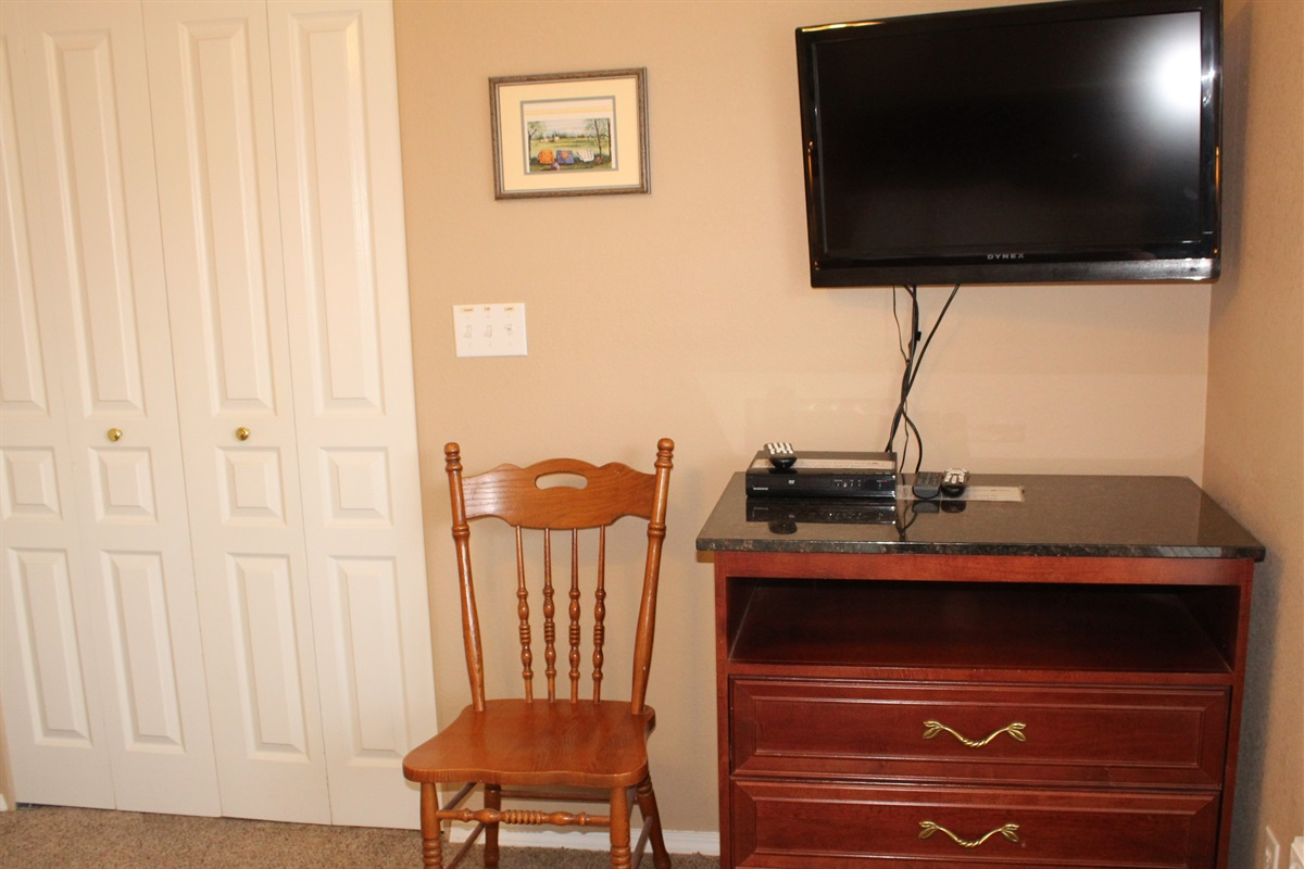 The guest bedroom also has a ceiling fan, 32 inch HD TV and a DVD player.