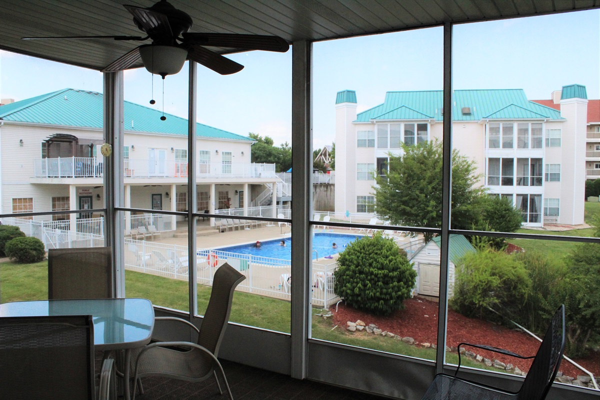 The closest pool can be viewed from the screened porch. Seating for 6.