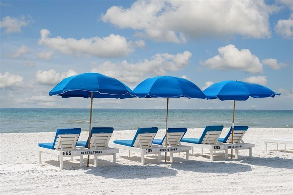 Complimentary Daily Beach Service with Chairs & Umbrellas March thru mid-Oct