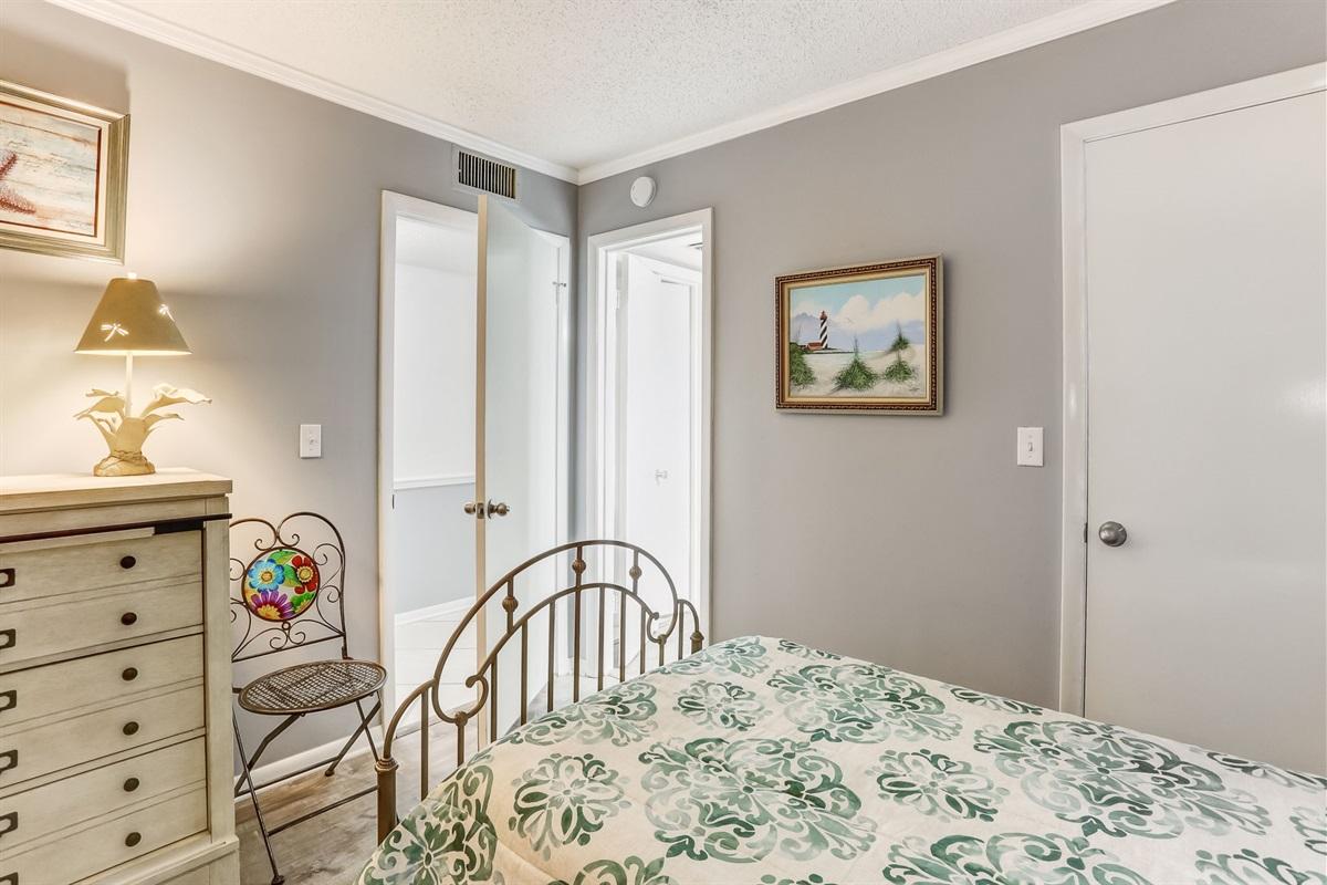 Dresser and Bathroom in Twin Bedroom
