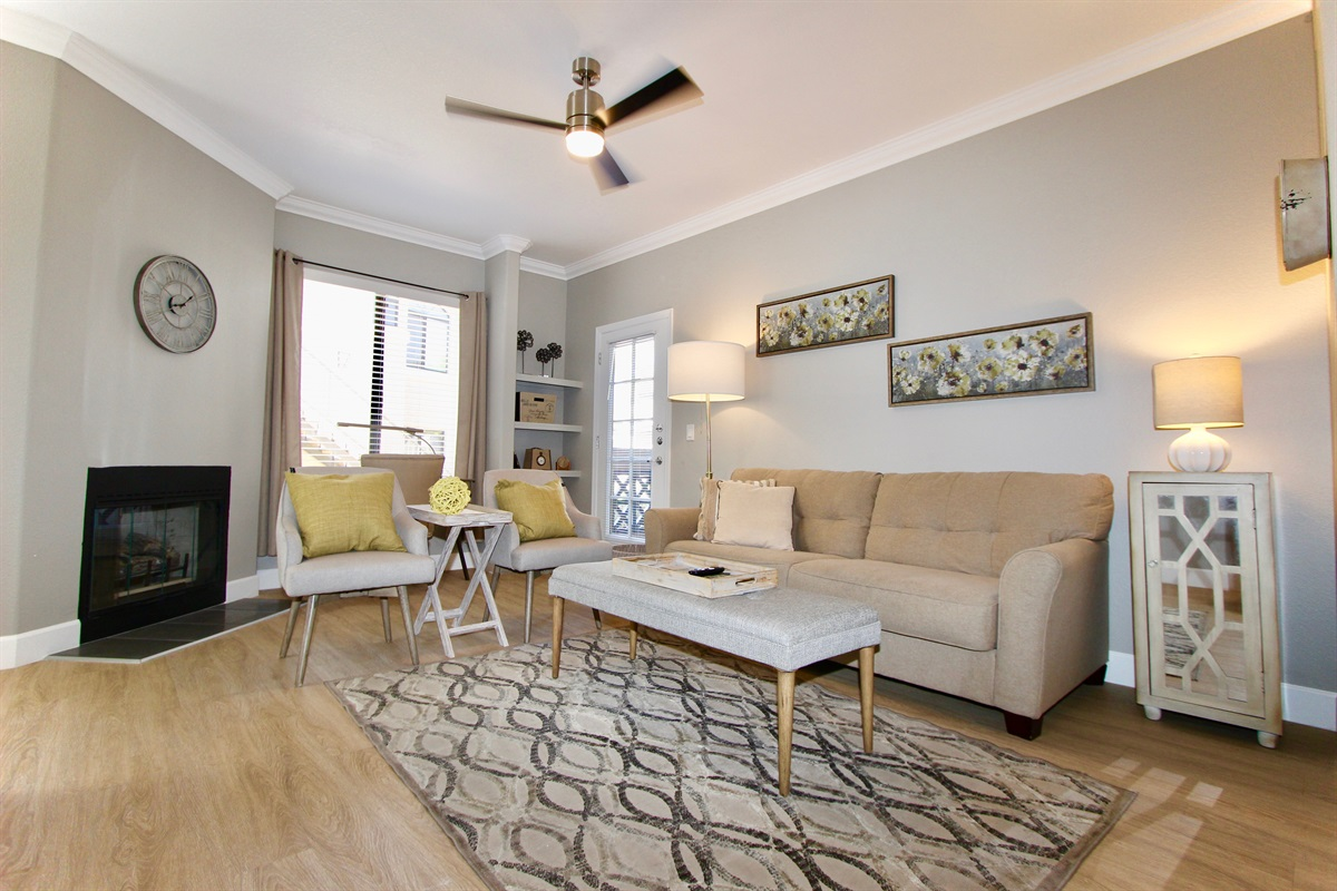 Living area, large couch, side chairs, nice and bright.