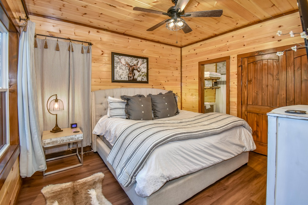Moose Den Master Suite with king bed and ensuite bath.
