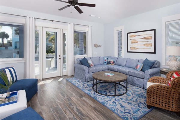 Open Living Area with plenty of comfy seating and lots of natural light