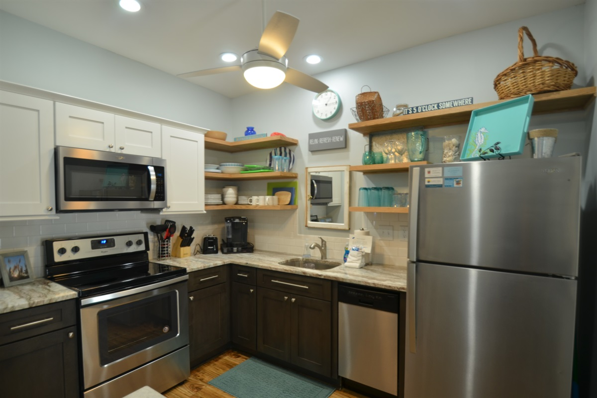 Kitchen with all essentials - pots, pans, dishes, utensils, bake ware...