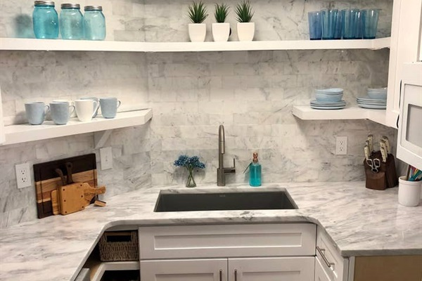 KITCHEN   Small but functional...welcome to the 'tiny' kitchen!    Completely remodeled and designed for a pleasing open and clean feel, this small space features a full sized dishwasher, disposal, full sized sink, open top shelves, built-in microwave, and