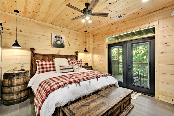 Each master suite includes luxurious hotel quality linens, a Westin Heavenly Bed mattress and an en-suite bath. French doors lead to the the lower deck with rockers overlooking the woods.