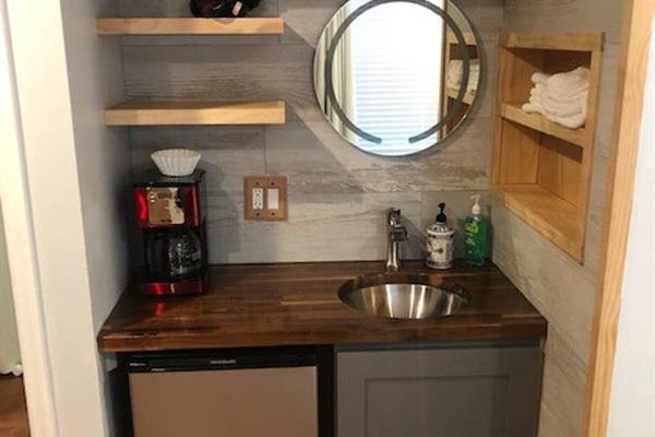 """Queen Suite (bottom floor)  Includes """"wet bar"""" (mini frig, coffee.) Second sink & mirror + hairdryer"""