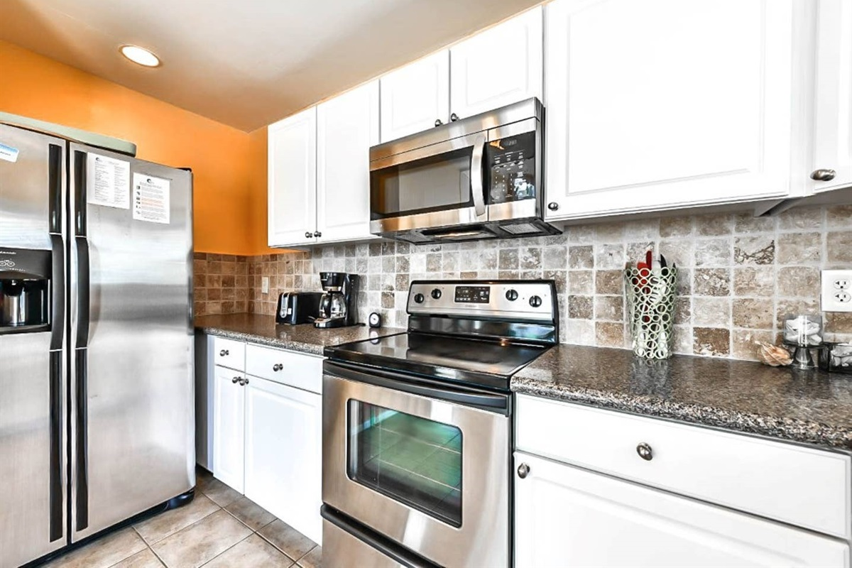 Kitchen with Granite Counter tops & Updated Stainless-Steel Appliances