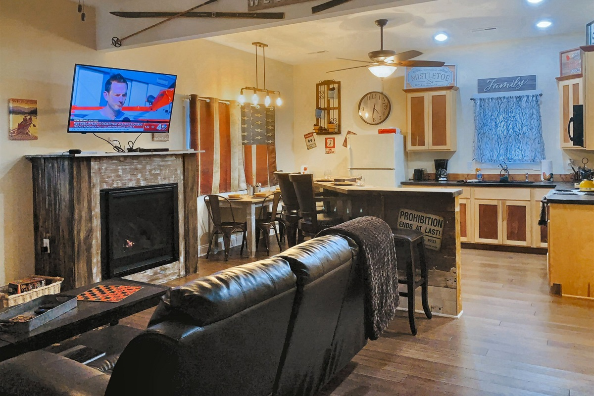 Open floor plan with living room, TV and kitchen