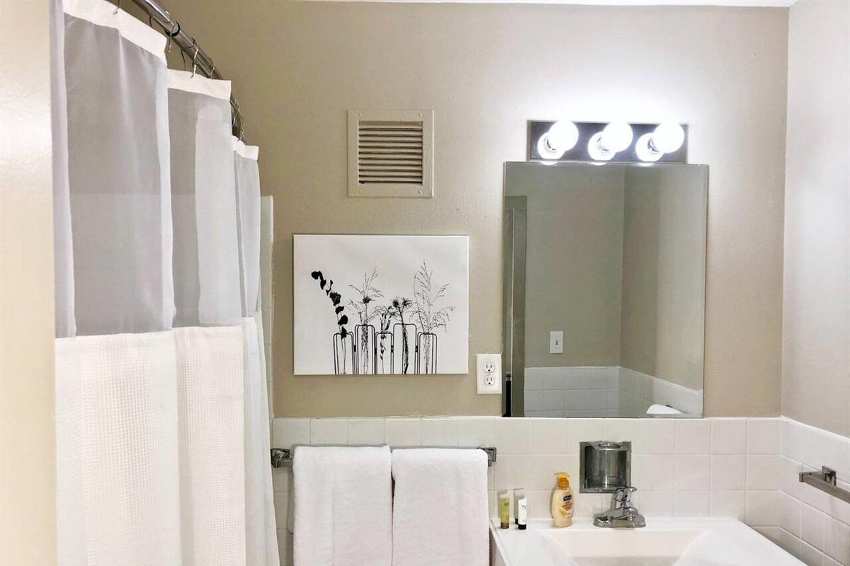 Bathroom with tub and complimentary soap & shampoo