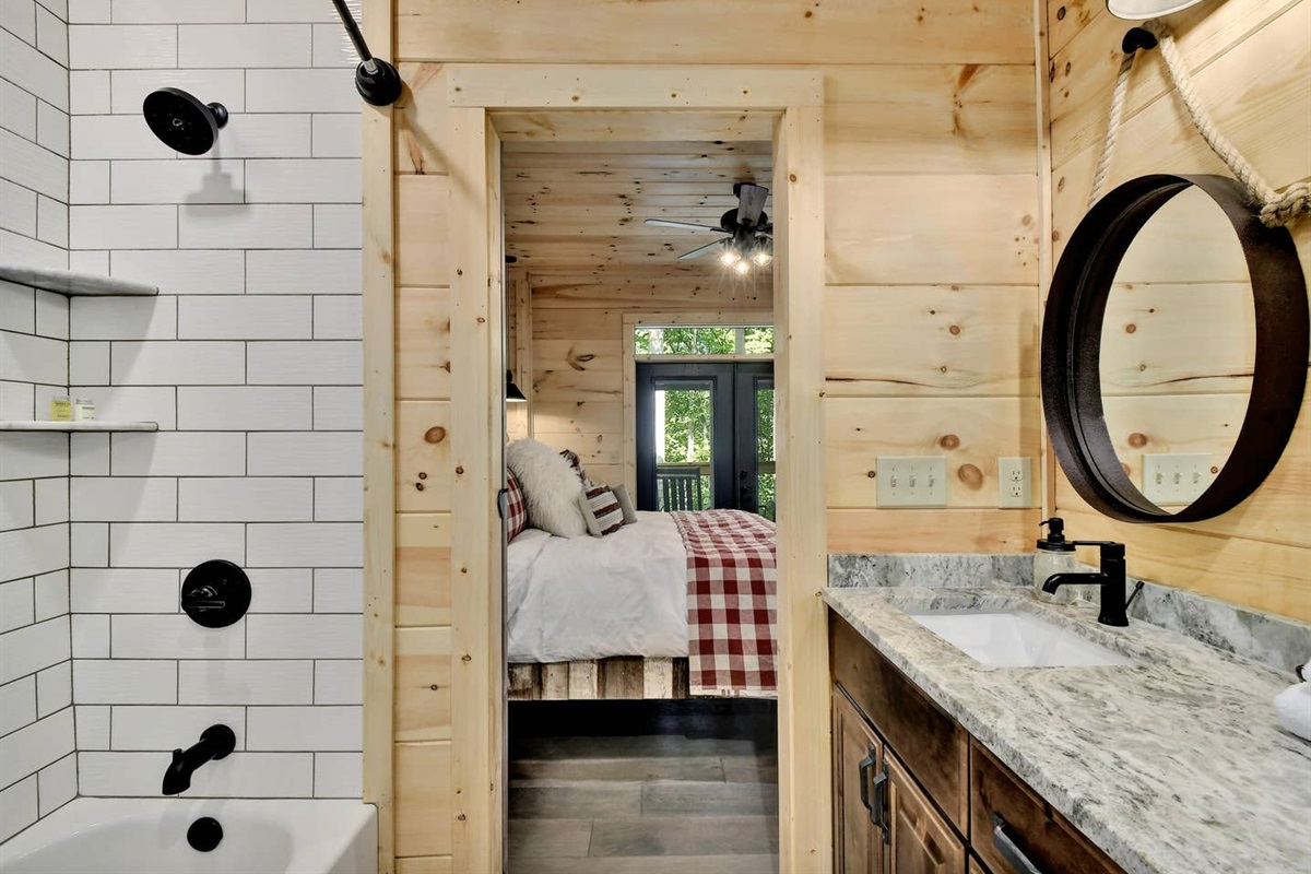 The Bear Cave en-suite bath features a tub/shower combo and dual vanities