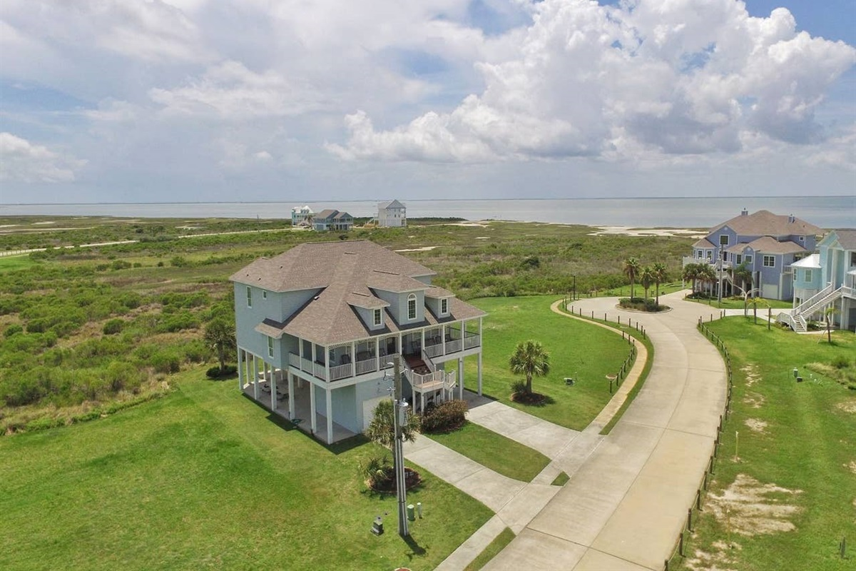 Aerial View of Bay House with Bay in Horizon