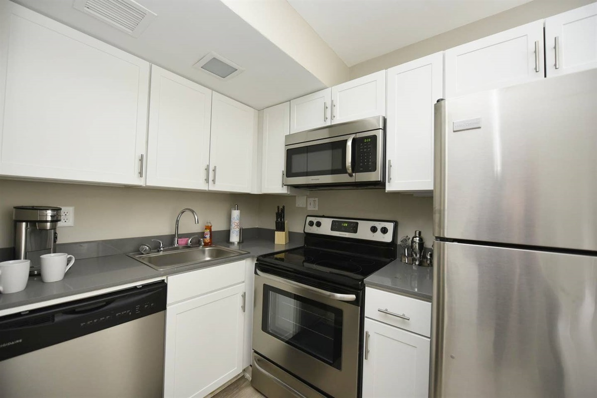 Fully equipped kitchen featuring all the basics and complimentary coffee maker