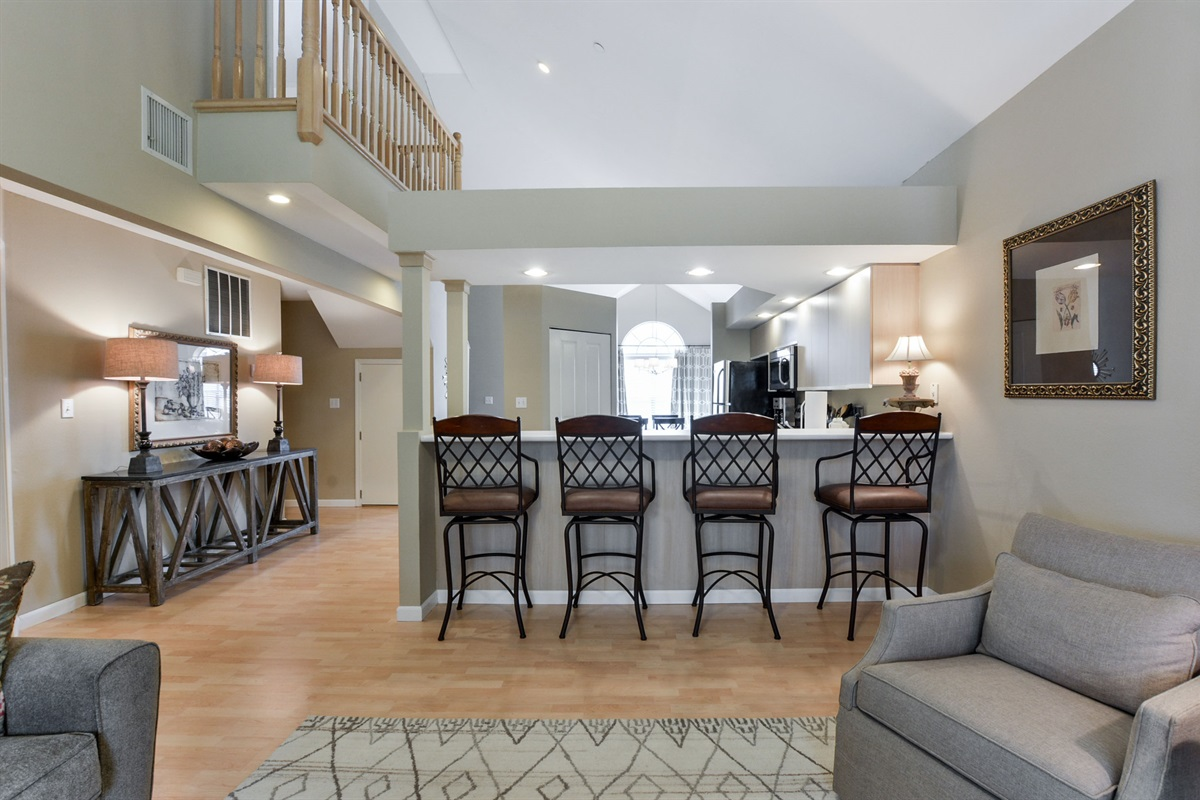 Enjoy time together with an open floor plan, bar seating, and view from the loft