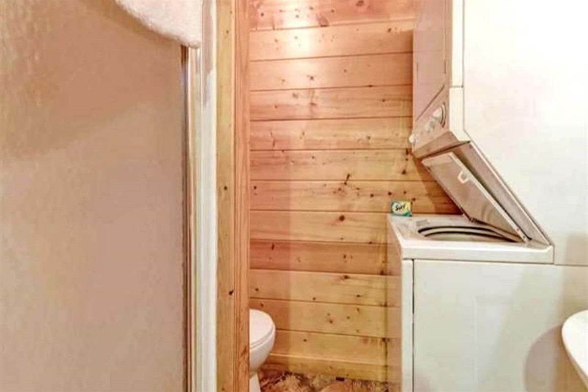 Laundry room/full bathroom in the gameroom/basement.
