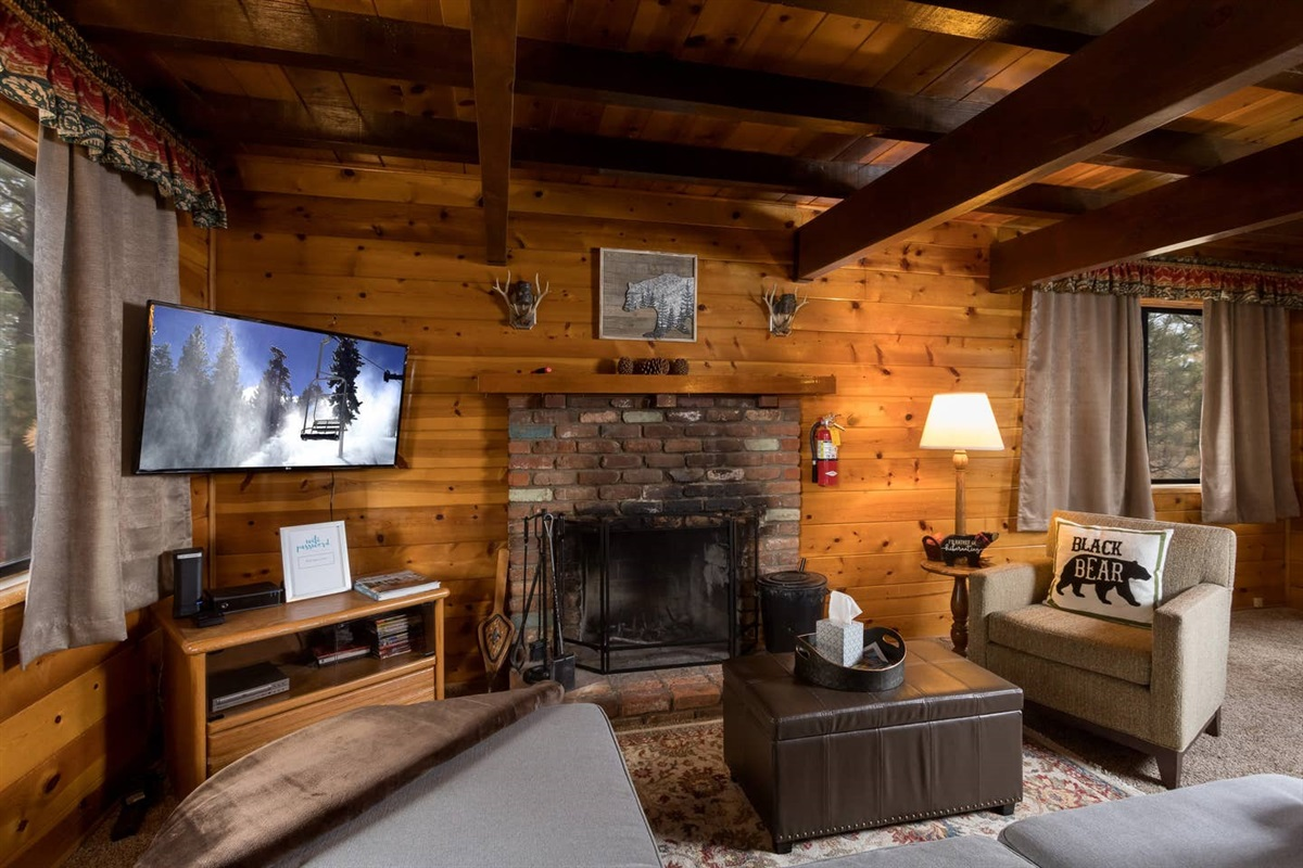 Living Room with wood burning fireplace, Roku TV (Just log into your own Netflix, Hulu, Disney+ account!)