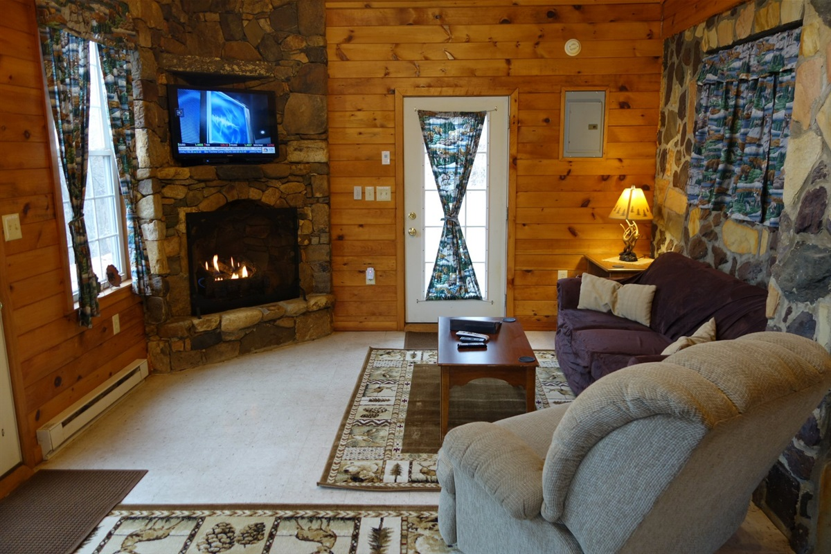 Warm fireplace, open living areas, modern HD TV