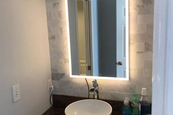 KING BEDROOM #2  (street side)  Private vanity with single sinks & mirror.