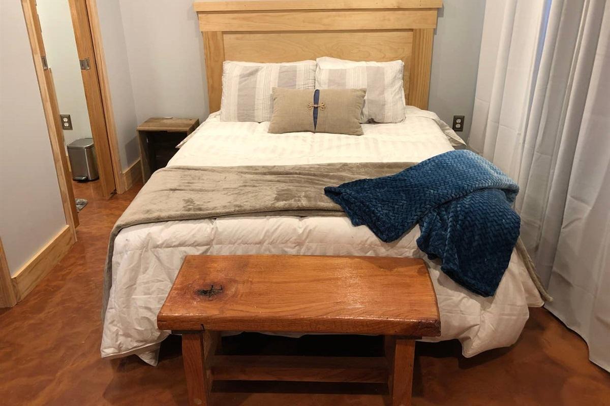 Queen Suite (bottom floor)  Queen bed, 12 inch memory foam mattress.