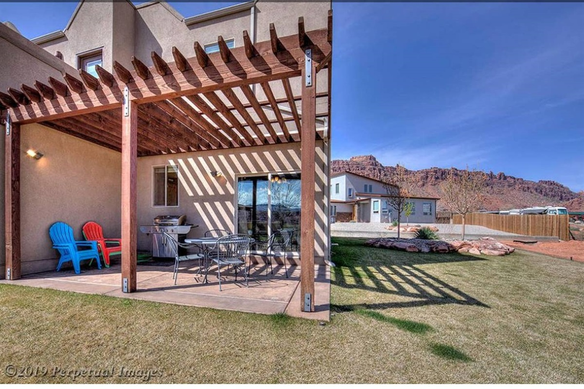 Covered private patio with Outdoor Living and Natural Gas BBQ