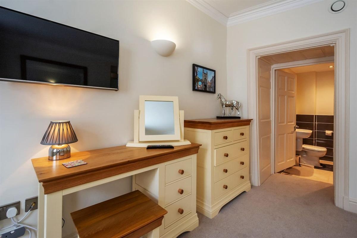 Bedroom 1 + en-suite with walk-in shower.