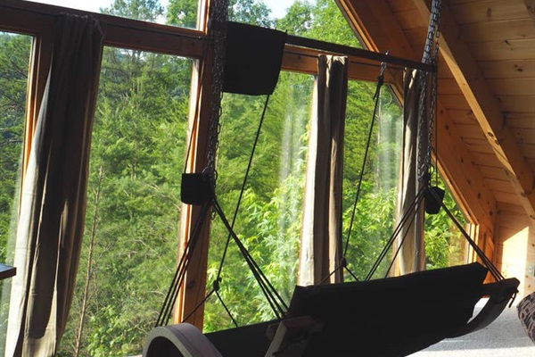 Relax and kick your feet up  in the hanging love seat.  During the day, the loft gets hot, so we added new energy efficient curtains. We hope it will reduce some heat while you are not viewing the beautiful mountains.