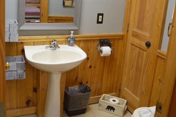 Lower level bathroom has a tub shower.