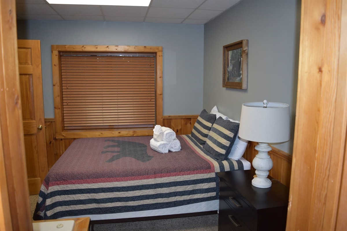 Lower floor bedroom has a Queen size bed.  This bedroom is adjoining the game room.