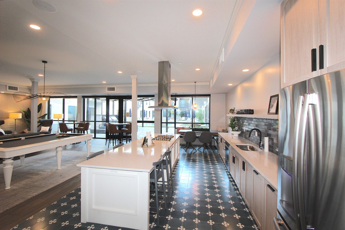 Club house with pool table, large TV, kitchen