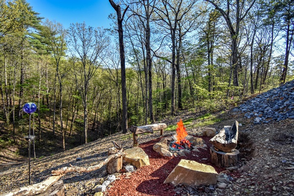 Fire-pit with benches built from reclaimed wood from Great Smoky Mountain National Park.
