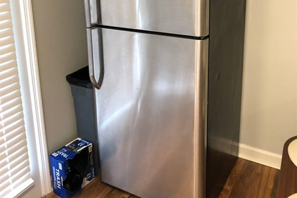 REFRIGERATOR  Full sized refrigerator. (Includes freezer, but does not have an ice maker nor water dispenser.)  Trash can and bags provided.