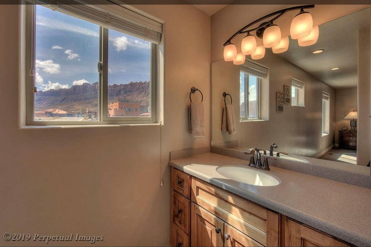 Master bathroom with red rock view