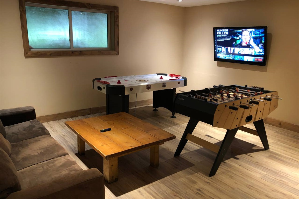 """Lower level game room with Air Hockey, Foosball Table and 50"""" HDTV connected with Netflix & Amazon Prime Video"""