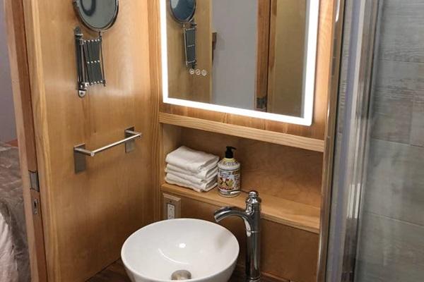 Queen Suite (bottom floor)  Lighted vanity mirror